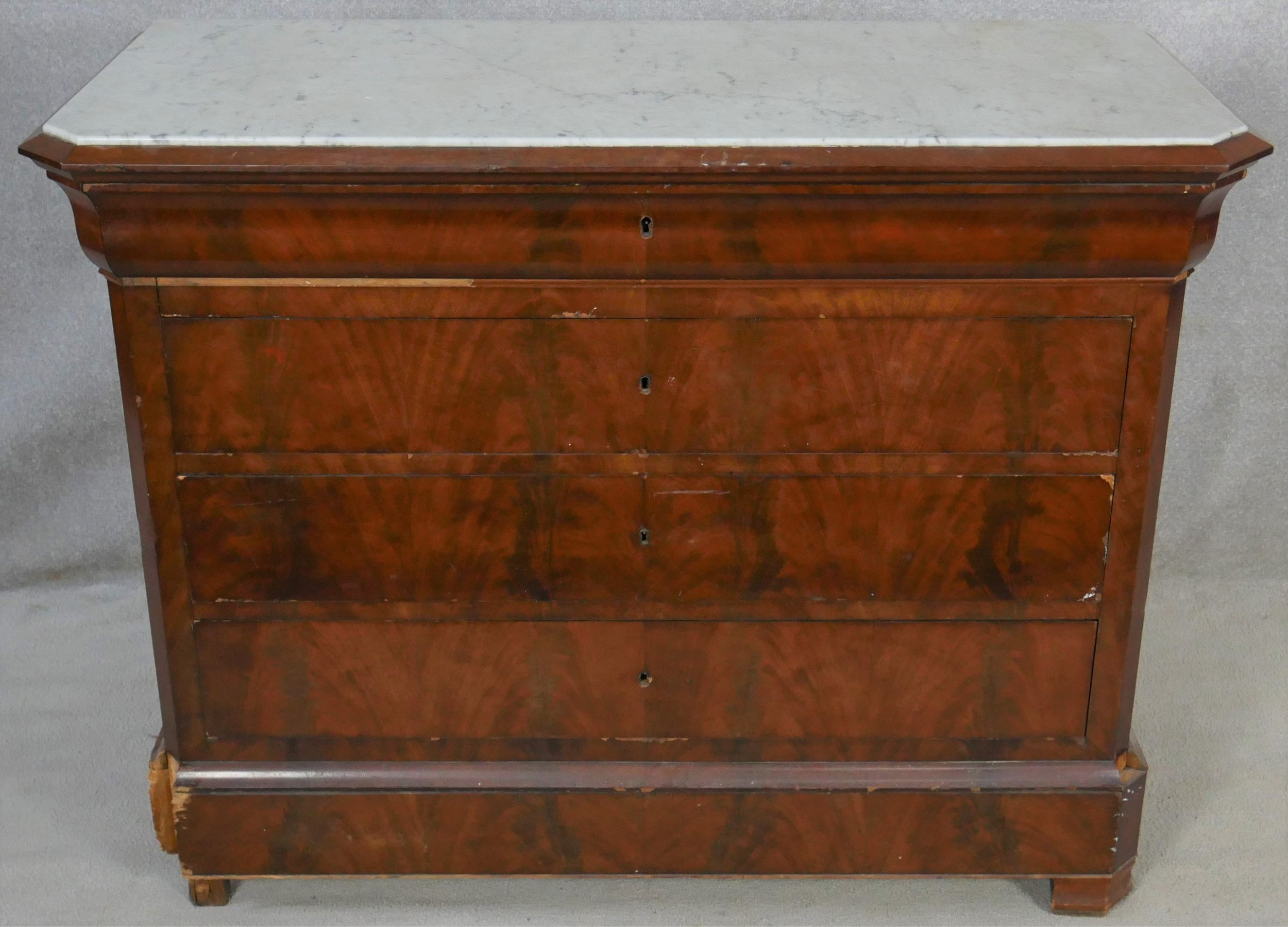 A 19th century French Louis Phillipe figured mahogany commode with marble top above four long - Image 3 of 6
