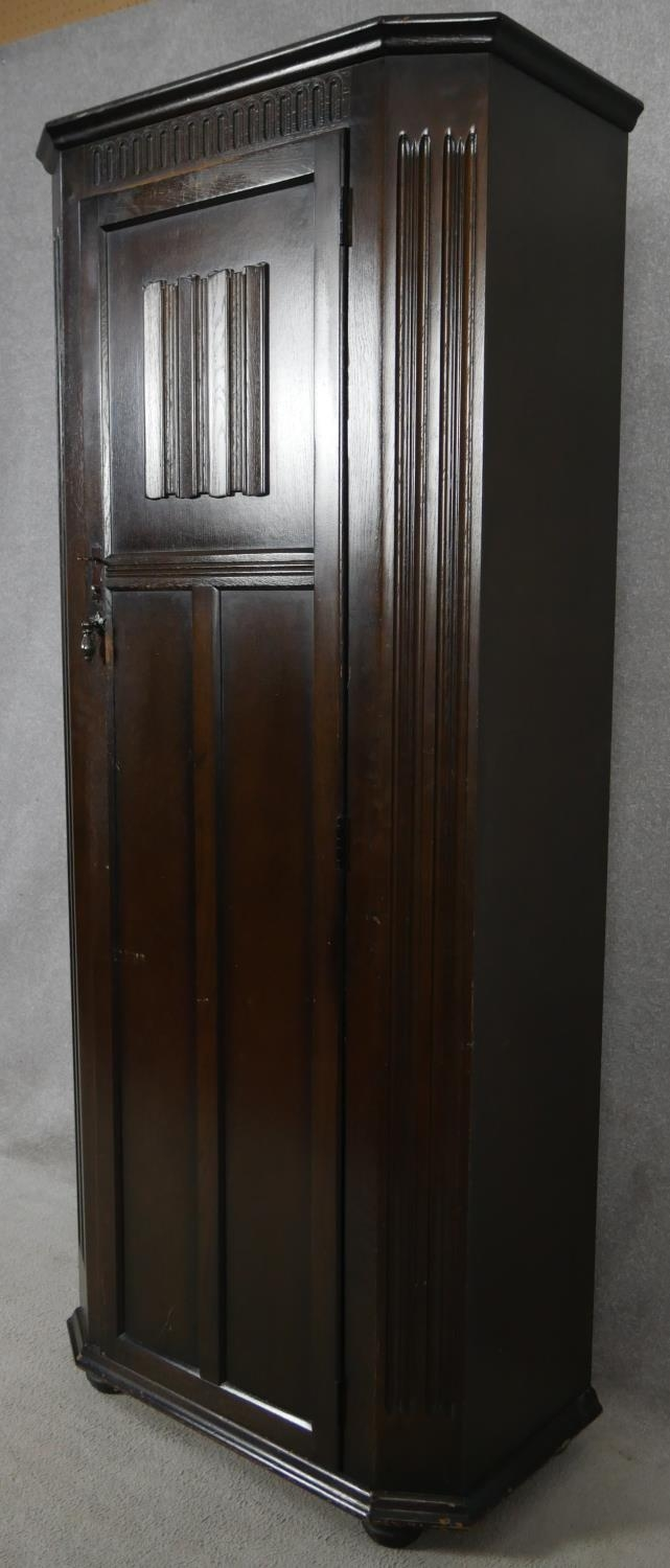 A mid century oak Jacobean style floor standing hall cupboard with carved linenfold panel door on - Image 8 of 9