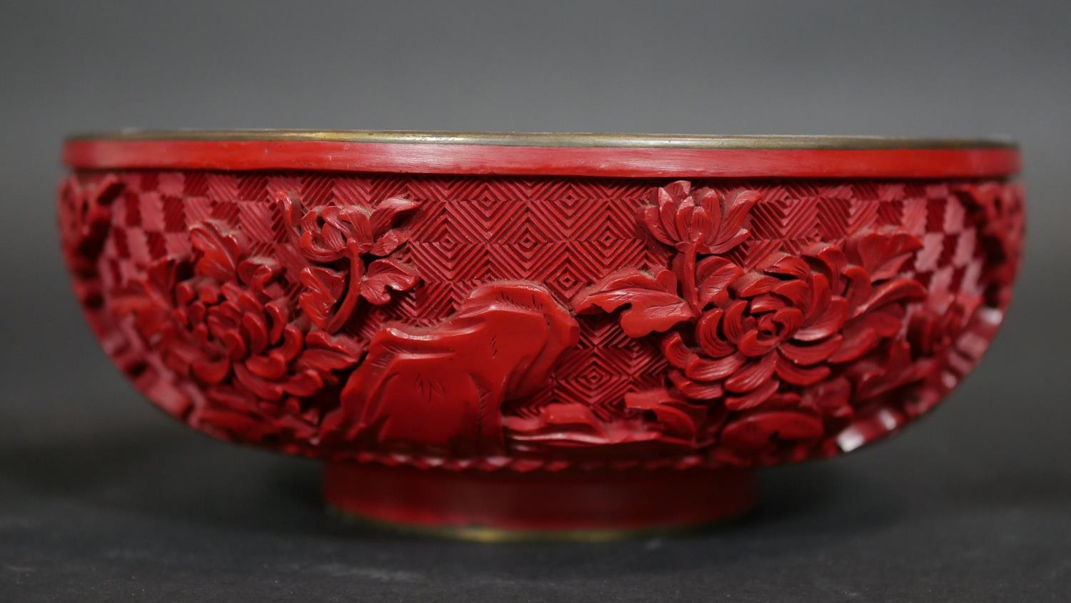 A Chinese carved cinnabar lacquer bowl with blue enamel interior and a pair of similar vases. Dia. - Image 5 of 9