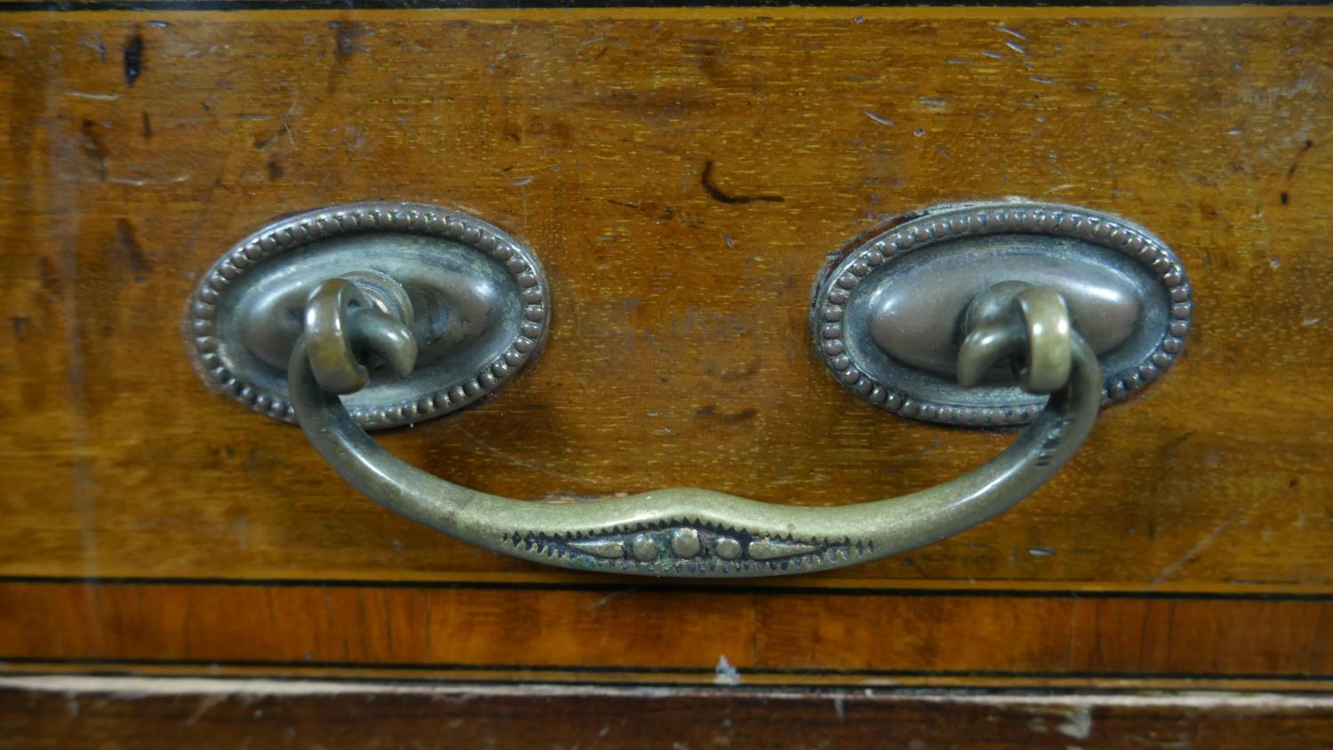 An Edwardian mahogany and crossbanded kneehole desk with inset leather top raised on square tapering - Image 5 of 9
