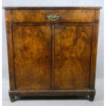 A late 19th century Continental burr walnut chiffonier with frieze drawer above panel doors on