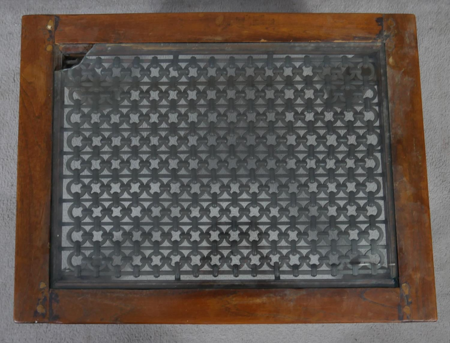 An Indian hardwood occasional table with plate glass on a metal lattice work inset top. H.38 L.68. - Image 2 of 5