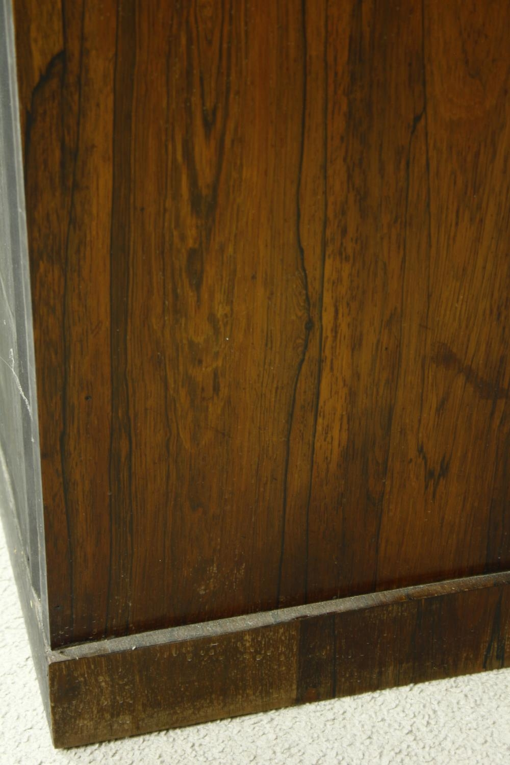 An early Victorian rosewood pier cabinet with arched panel door enclosing shelves on plinth base. - Image 8 of 11