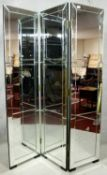 A two fold room divider with three mirrored panels each with bevelled and glazed framed sections.