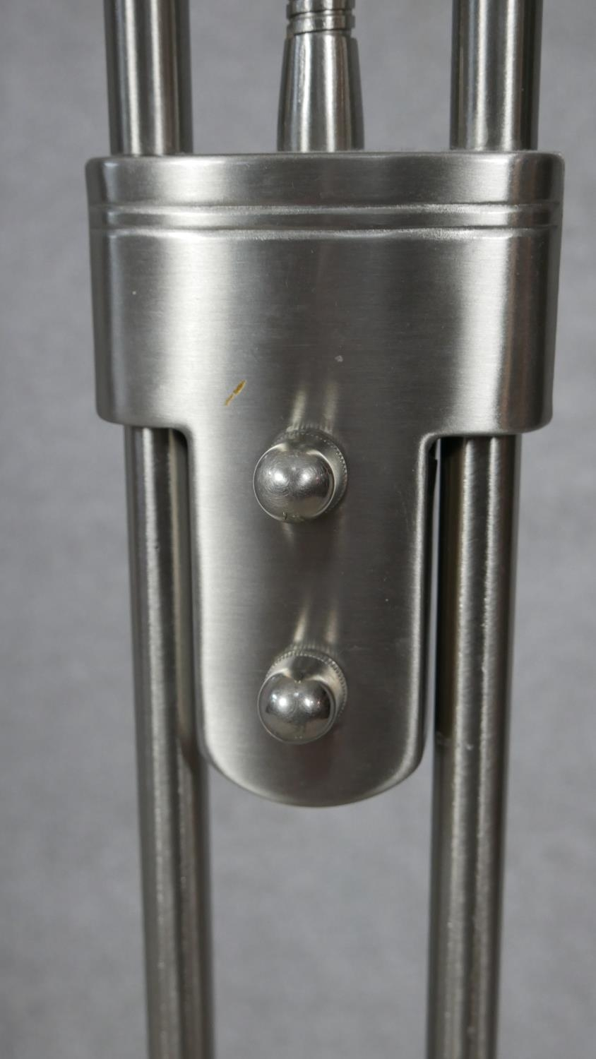 A contemporary chrome standing uplighter with adjustable reading lamp arm. H.182cm - Image 3 of 4