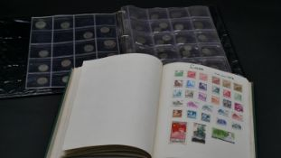 A collection of world stamps in a twenty five page album and a seven page collector's wallet of