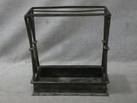 A vintage cast iron stick and umbrella stand with two long sections and lattice design ends. H.62
