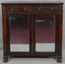 A Regency rosewood chiffonier with lion's mask handles and mirrored doors with original plates