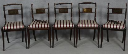 A set of five Regency mahogany brass inlaid dining chairs with rope twist backs and drop in seats on