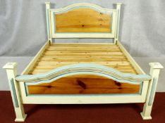 A contemporary painted pine bedstead for a 5ft mattress.