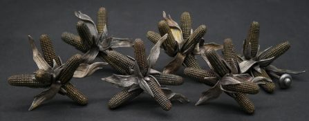 A set of six cast metal furniture handles in the form of corn ears.