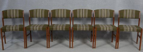 A set of six mid century vintage teak dining chairs in original upholstery. H.77cm