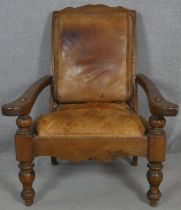 A 19th century teak planter's style armchair with folding leg rests in leather upholstery on