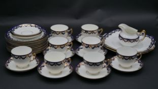A Paragon porcelain tea service in blue and white with gilt highlights with maker's mark to the