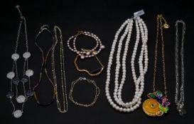 A collection of jJewellery. To include a pink freshwater pearl double strand bracelet, a three
