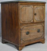 A Georgian pale mahogany ebony strung bedside cabinet with plate glass top on bracket feet.58.5 D.