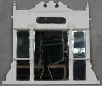 A late 19th century painted overmantel mirror with triple bevelled plates. H.87 W.101cm