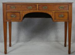 A 19th century mahogany writing table with original plate brass handles on square tapering