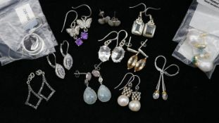 Twelve pairs of gemset silver earrings. Including a pair of topaz and amethyst butterfly drop