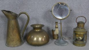 A vintage brass shaving mirror on stand, a brass cased lantern and a brass jug and vase. H.39cm (