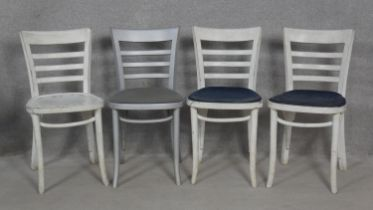 A set of four painted bentwood dining chairs. H.80cm (some damage as photographed).