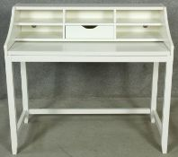 A contemporary desk with fitted interior and slide-out writing surface. H.95 W.105 D.52cm