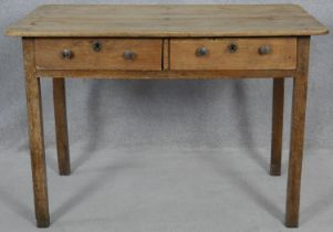 A 19th century fruitwood side table with a pair of frieze drawers on square section supports. H.77