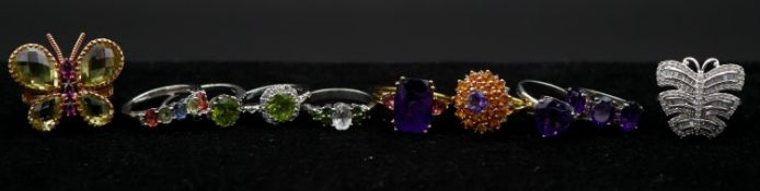 A collection of ten gemset silver rings with certificates. Including a lemon quartz and rhodolite
