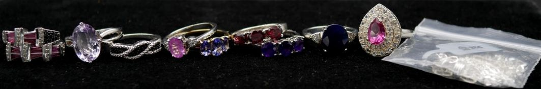 A collection of ten gem set silver and gold rings with certificates and a silver figaro chain.