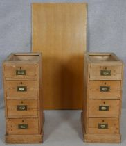 A pair of 19th century pine military style pedestals with inset brass handles along with a modern