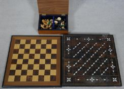 A box containing a chess and draughts set, a chess board and a backgammon board. L.50 W.50cm