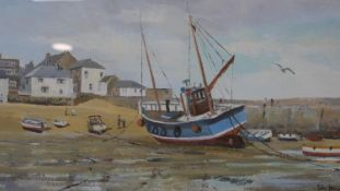 A framed and glazed watercolour, fishing village with boats, signed John Hewitt. H.36 W.52.5cm
