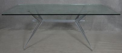 A 1980's plate glass topped dining table on metal base, T/38 by Studio Archirivolto for Fasem. H.
