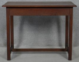 A late 19th century country oak side table with moulded top on square section stretchered