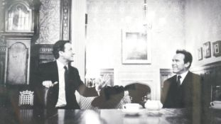 A framed presentation photograph of David Cameron and Arnold Schwarzenegger at Chequers, signed by