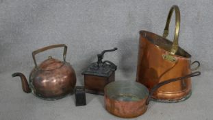 A brass and copper coal scuttle, a copper pan and teapot, a vintage coffee grinder and a 2lb weight.