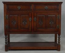 A mid century carved oak Jacobean style sideboard by Old Charm Furniture. H.91.5 W.107 D.41cm