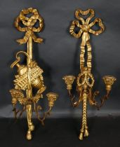 A late 19th century carved giltwood and gesso twin branch wall sconce with ribbon and swag