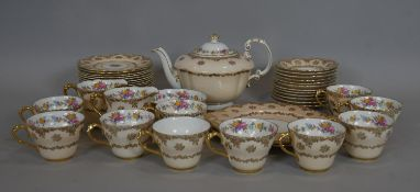 A late 19th century hand gilded and decorated Paragon tea service to include 18 plates, 10 cups with