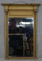 A 19th century gilt pier mirror, the plate flanked by Corinthian columns on plinth base. H.114 W.