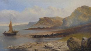 A 19th century gilt framed oil on board, rocky coastline with a sailing boat, indistinctly