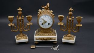 A late 19th century French ormolu mounted mantel clock with hand decorated dial and eight day
