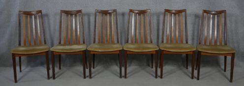 A set of mid century vintage teak G-Plan dining chairs with maker's label to the underside. H.91cm