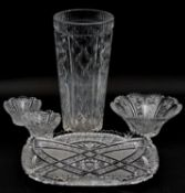 A collection of cut crystal and glass items. Including a large cut crystal vase with geometric