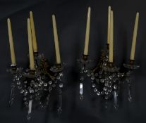 A pair of vintage gilt metal four branch wall sconces with cut crystal swags and drops. W.35cm