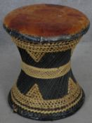 A vintage Indian wicker stool with leather seat. H.43 D.39cm