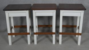 Three contemporary white painted and teak high stools. H.70.5 L.47 W.47cm