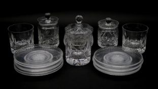 A collection of cut crystal items. Inlcuding a set of eleven side plates with star cut design, three