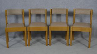 A set of four contemporary teak kitchen chairs. H.78cm