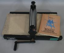 A Tofko Danish Norup Mini lithograph print makers press, with retailers label and book 'The